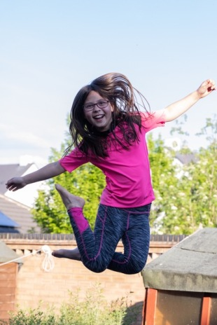 pre-teen girl in mid-air